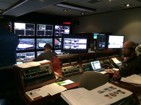 Inside the production truck where the producer and director and graphics and others sit